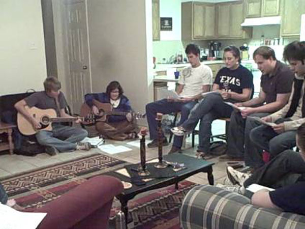 Church worshiping in a living room